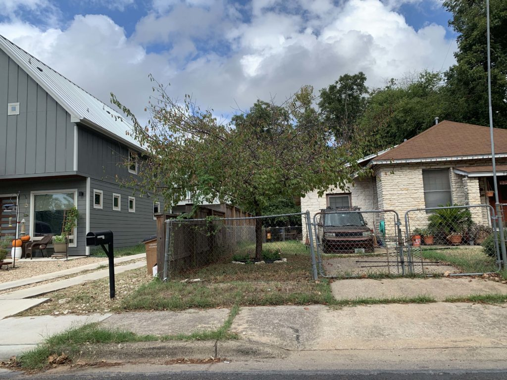 Condo and older home in opportunity zone in Austin