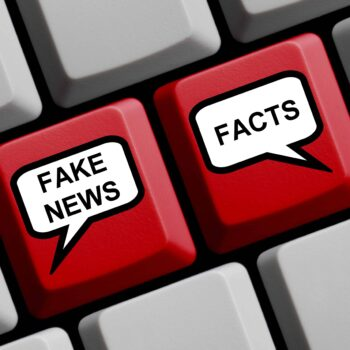 Keyboard showing fake news and facts as keys