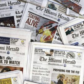 Copies of The Miami Herald, which Margaret Sullivan notes doggedly reported on Jeffrey Epstein's sex trafficking.