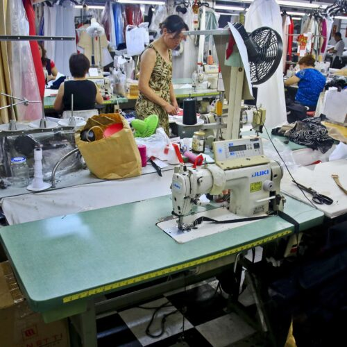 Garment workers assemble clothing