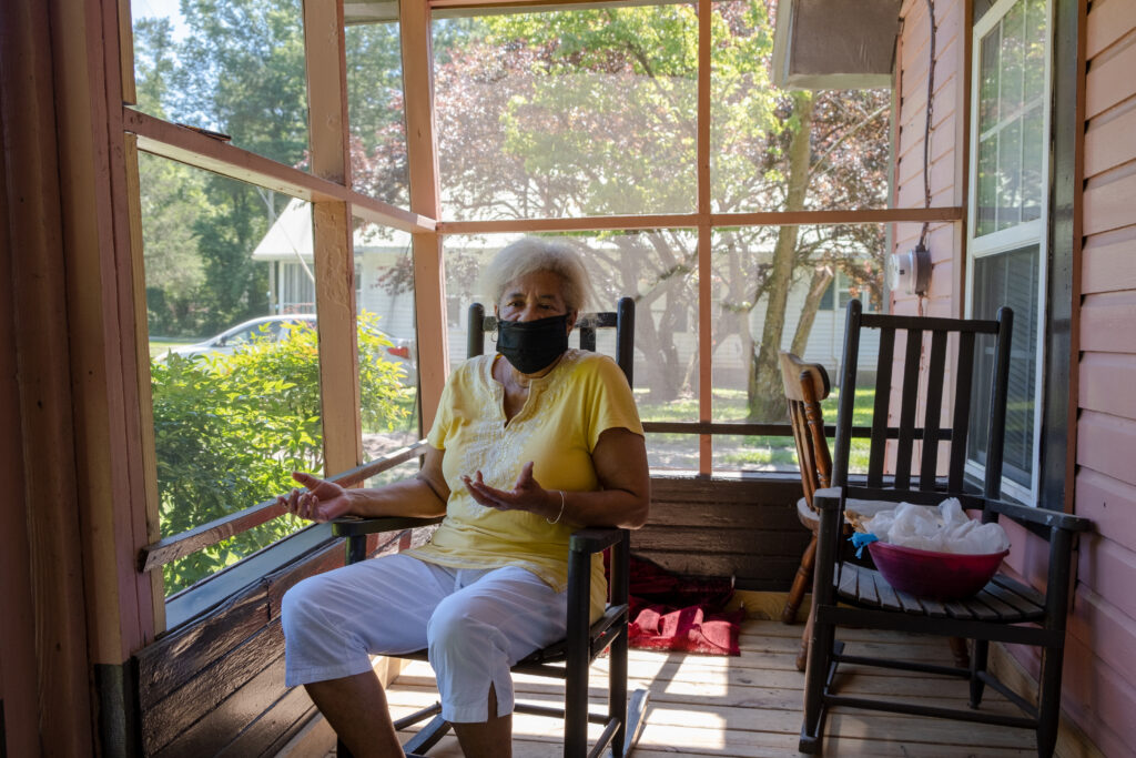 Elsie Herring sits on the porch of her home in Duplin County, N.C. Herring worries about the pollution and the smell of hog manure sprayed on a field next door.