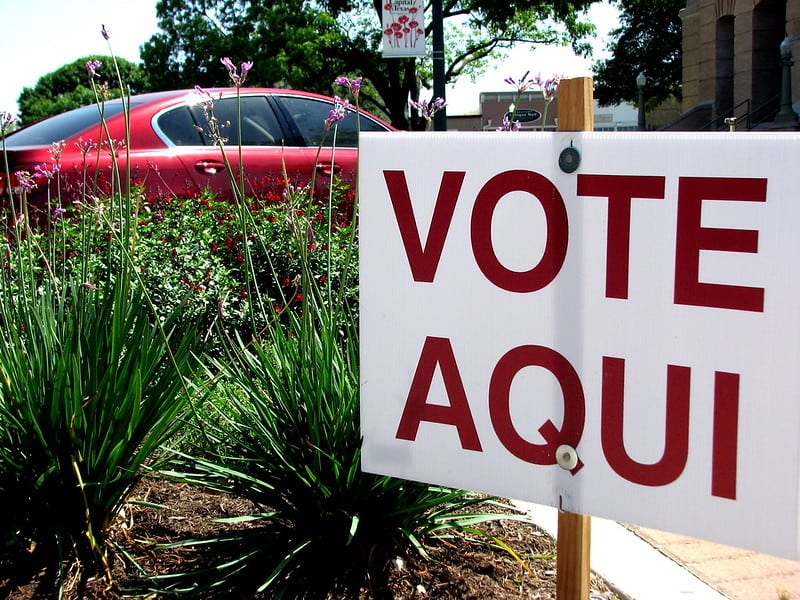 A sign marks a polling place in Texas, where exercising the right to vote will be more difficult than usual in 2020.