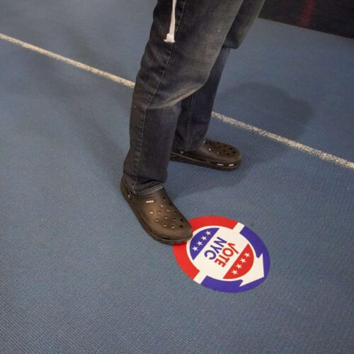 Voters stand six feet apart while waiting to vote early