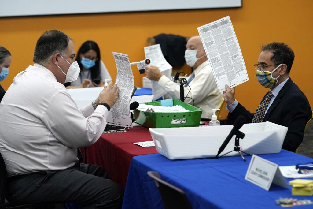 An attorney examines a ballot