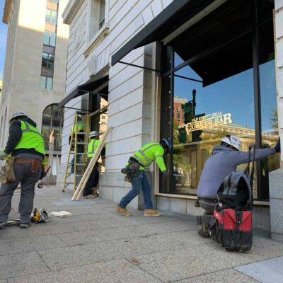Workers board up the Old Ebbitt Grill