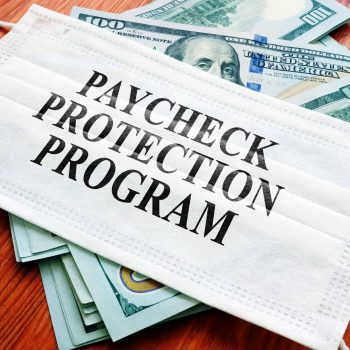Paycheck Protection Program (PPP) written on the mask and money.