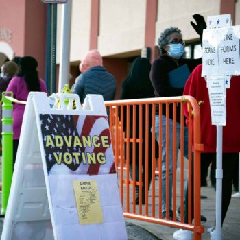 Residents in Cobb County line up to vote in the Georgia runoff election.