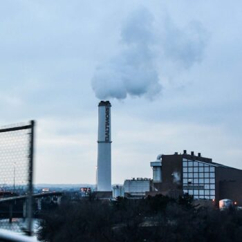 The smokestack of the Wheelabrator Incinerator is seen in Baltimore. Environmental justice is at a turning point.
