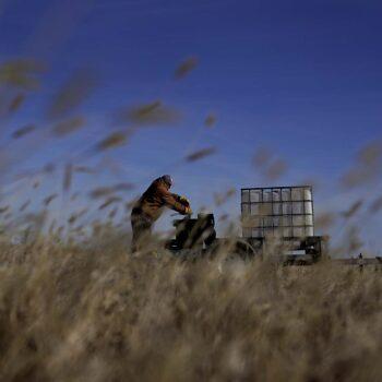 Rod Bradshaw, a Black farmer, tries to start an air compressor as he does chores on his farm near Jetmore, Kansas.