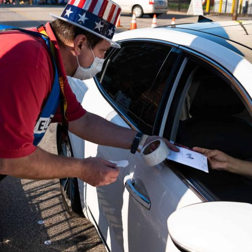 John Eddy collects absentee ballots from Ohio voters.
