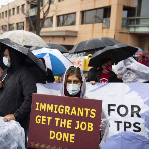 Demonstrators are seen before a march to call on the Senate to pass the American Dream and Promise Act.