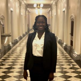 Astou Thiane is as an assistant principal. She advocates for a path to citzenship.