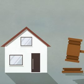 Illustration of a house with a gavel next to it. This story explains what is an eviction moratorium.