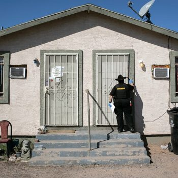 Maricopa County constable Darlene Martinez knocks on a door before posting an eviction order. The CDC eviction moratorium expires June 30, 2021.