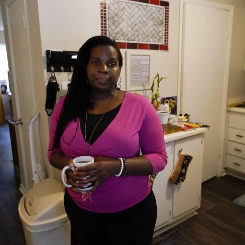 Dylyn Price of Athens, Ga., looks out a doorway from her kitchen at her rented townhome.