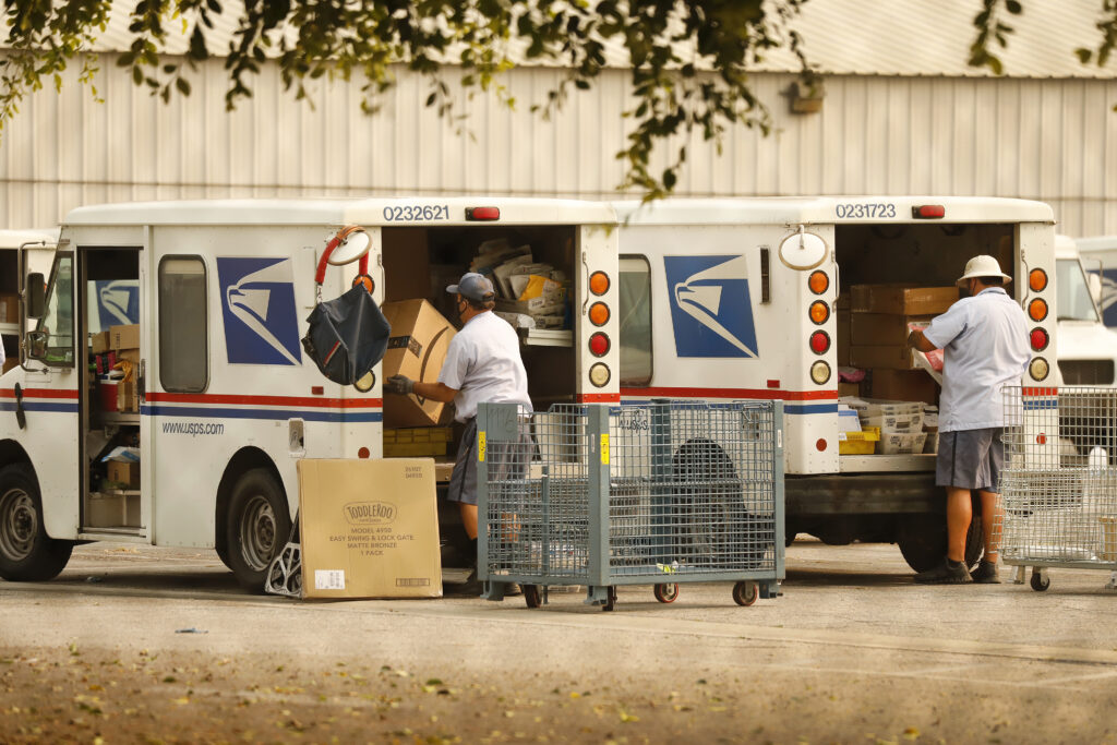 Mail carriers load their trucks at the USPS located in Van Nuys, California.